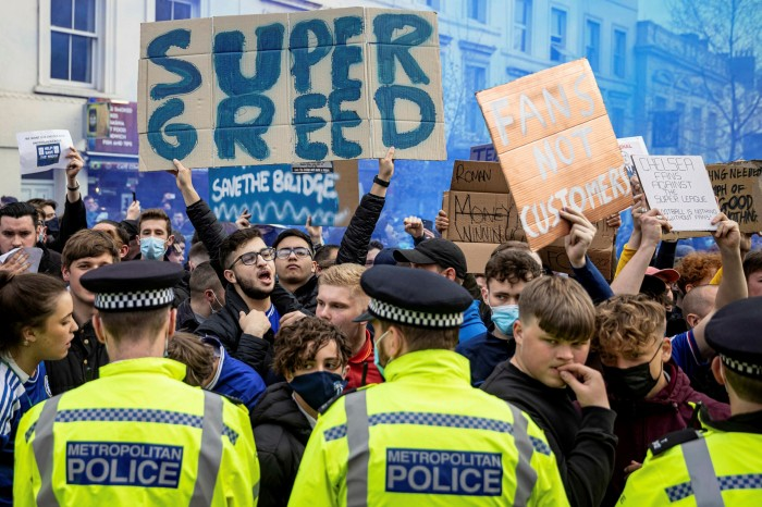 Chelsea fans protest against outside the club's Stamford Bridge stadium in London. 'The fans protested for the right to lose,' says one English Premier League club chair of the plans to protect the first 15 clubs in the Super League from relegation