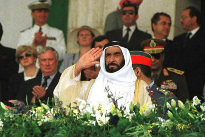 Sheikh Zayed bin sultan al-Nahyan, the UAE's founding father, salutes his military forces at a parade in Abu Dhabi in 1996