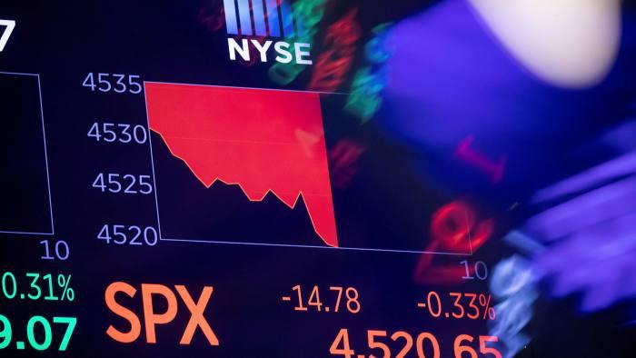 Monitors display stock market information on the floor of the New York Stock Exchange