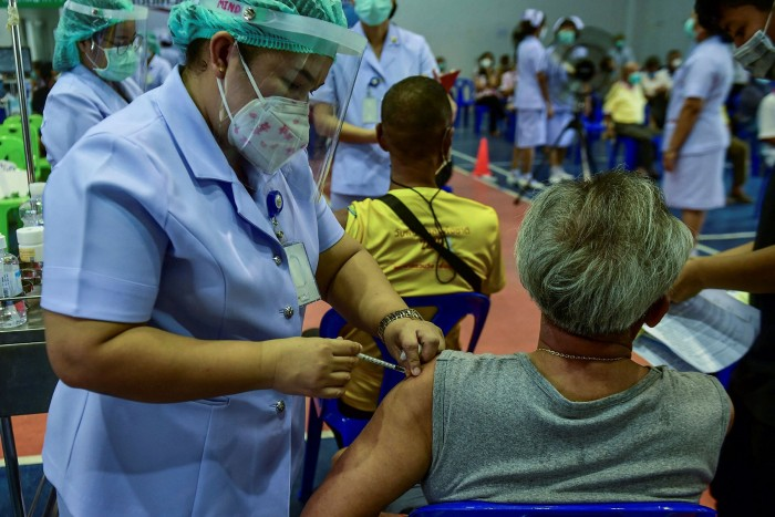 AstraZeneca vaccine doses are administered at the Narathiwat Hospital compound on Monday. 'Vaccines will be the force to drive the country forward with security and sustainability,' Prayuth Chan-ocha, prime minister, wrote on Facebook