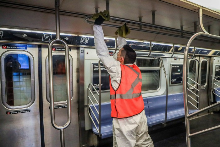 An employee cleans a subway car as part of decontamination efforts on May 17