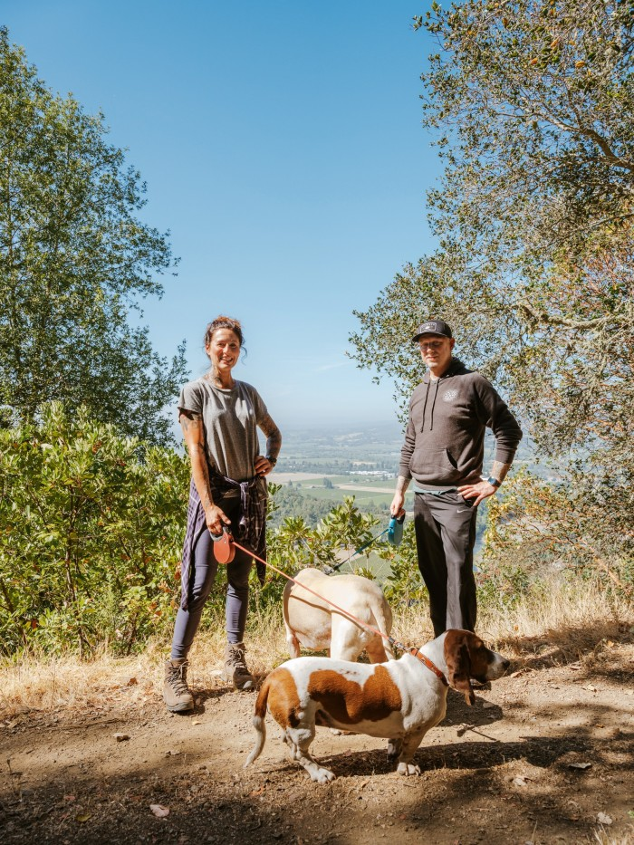 Kyleand Katina Connaughton hiking with hounds Murray and Bertie