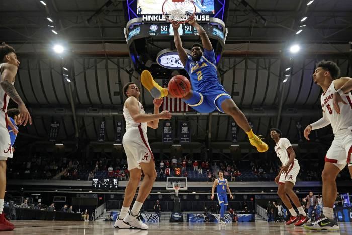 Cody Riley #2 of the UCLA Bruins dunks against the Alabama Crimson Tide in the Sweet Sixteen round of the 2021 NCAA Division I Men's Basketball Tournament held at Hinkle Fieldhouse in March