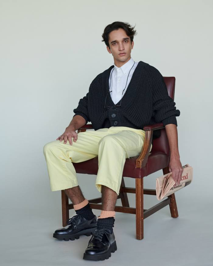 Noah wears Prada cotton cardigan, £880, cotton shirt, £510, denim trousers, £545, cotton socks, £140, and leather shoes, £610. Cutler and Gross glasses, £295. Bunney hammered 925-silver signet ring, £360, from doverstreetmarket.com