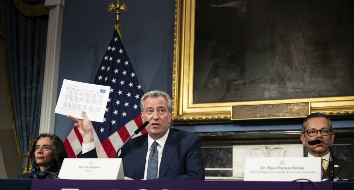 Bill de Blasio, mayor of New York, centre, and Oxiris Barbot, then public health commissioner, left, at a press conference in New York, on March 13