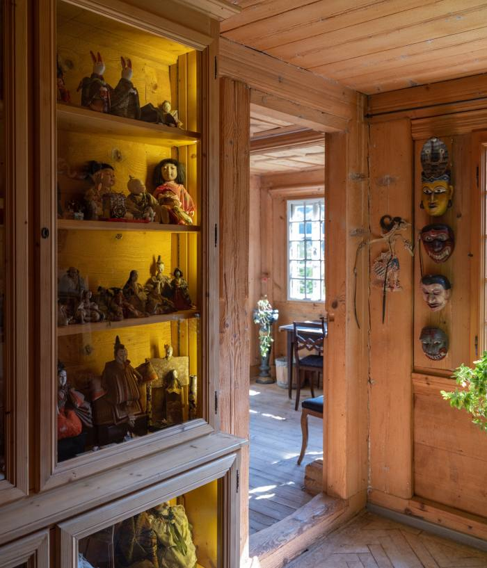 The glass-fronted cabinet with her parents' doll collection – some of them were madeby Setsuko