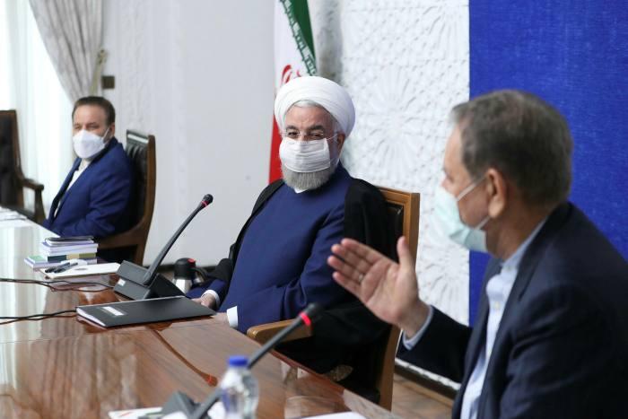 Hassan Rouhani, centre, Iran's president