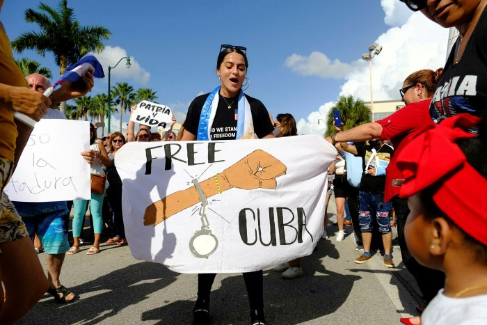 In Little Havana, émigrés react to reports of the protests in Cuba against the deteriorating economy, in Miami, Florida