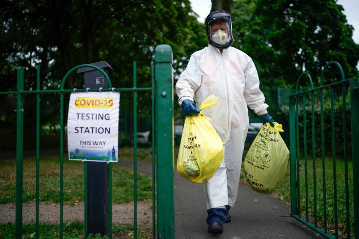 A Leicester city council employee at a testing centre. The UK initially abandoned mass testing in March as it lacked the capacity for a test-and-trace policy