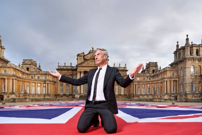 Maurizio Cattelan with his work Victory Is Not An Option at Blenheim Palace