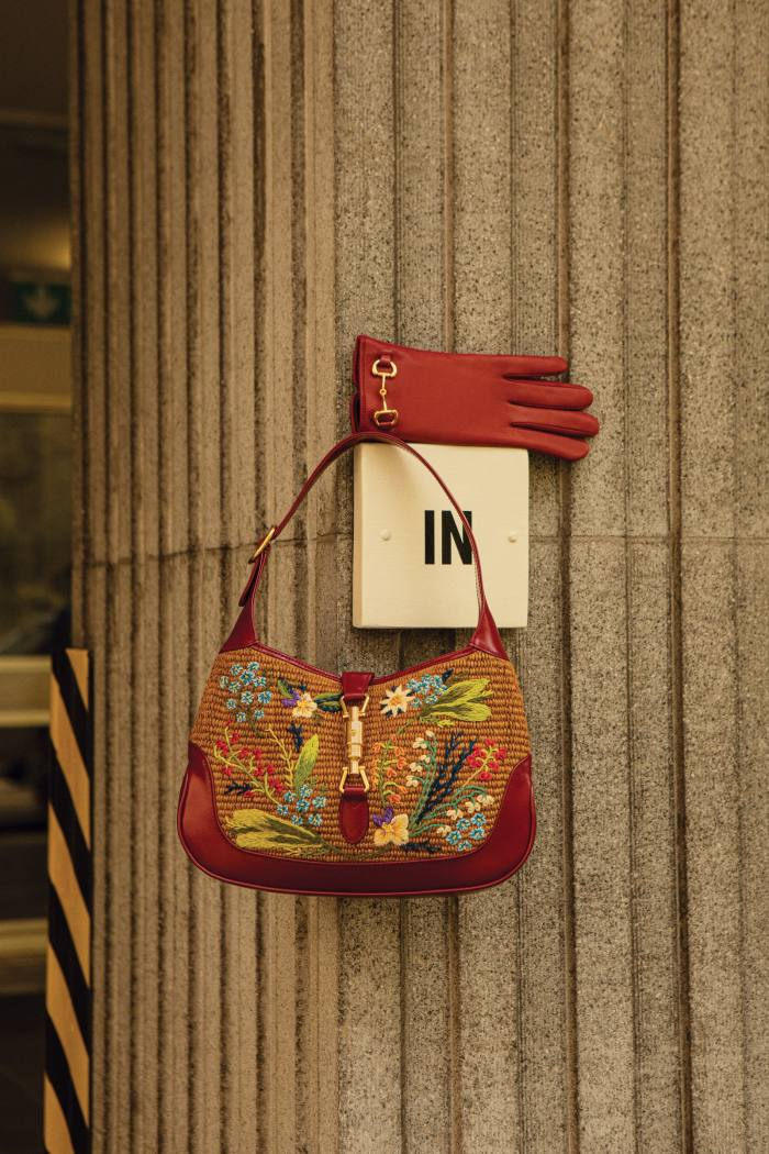 Gucci straw-effect fabric and leather small embroidered Jackie 1961 bag, £2,110, and leather gloves, £355