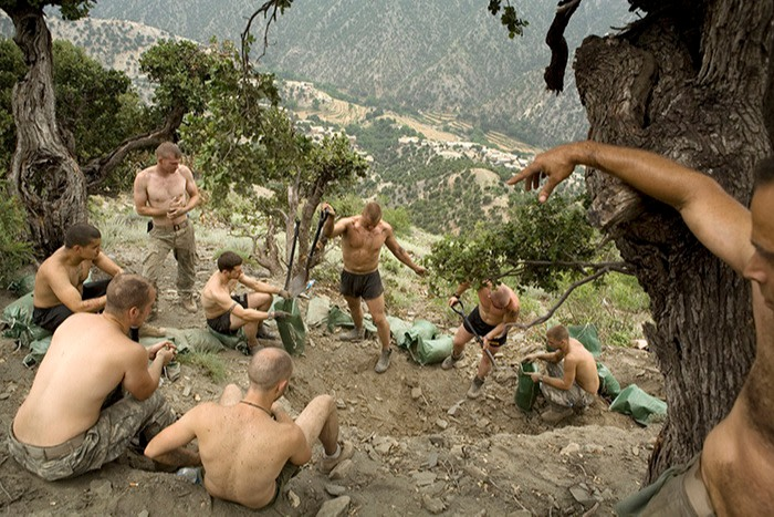 A platoon posted in Kunar province in 2008 dig earth for sandbags to reinforce a bunker