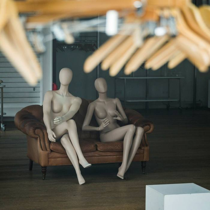 Mannequins sit in a permanently closed shop in London. In the City, the number of people visiting cafés, restaurants and retailers in the first week of October was less than one-third that of pre-pandemic levels