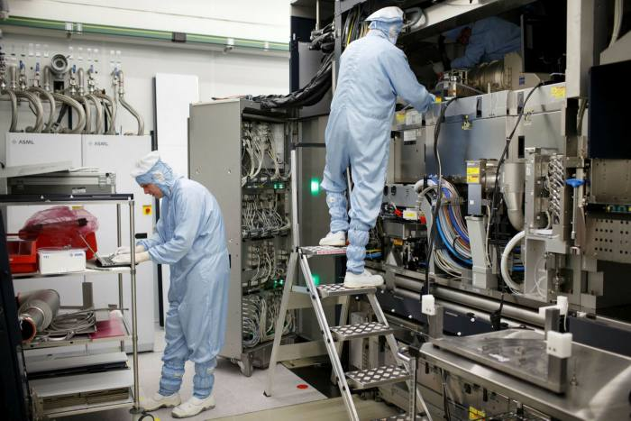 Employees of ASML working on the final assembly of semiconductor lithography toolsin Veldhoven, Netherlands