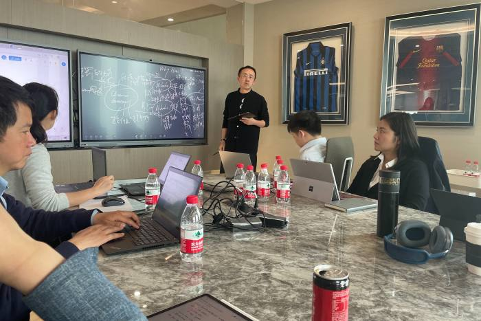 Patrick Zhong leading one of M31 Capital's weekly Monday meetings