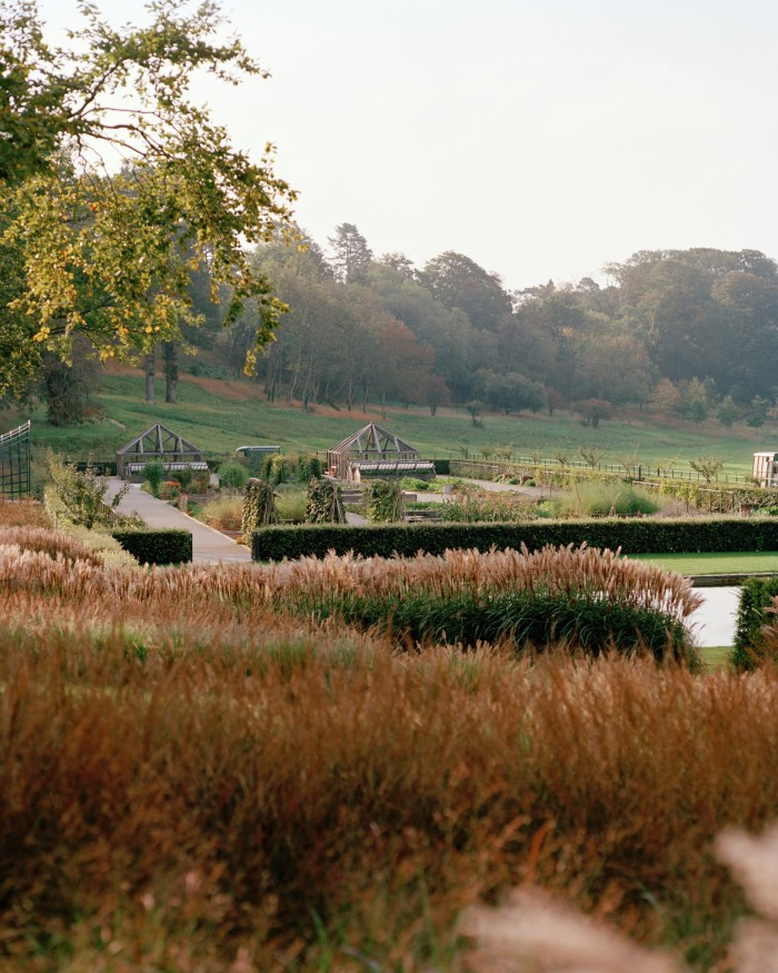 A view across the gardens to ancient woodland