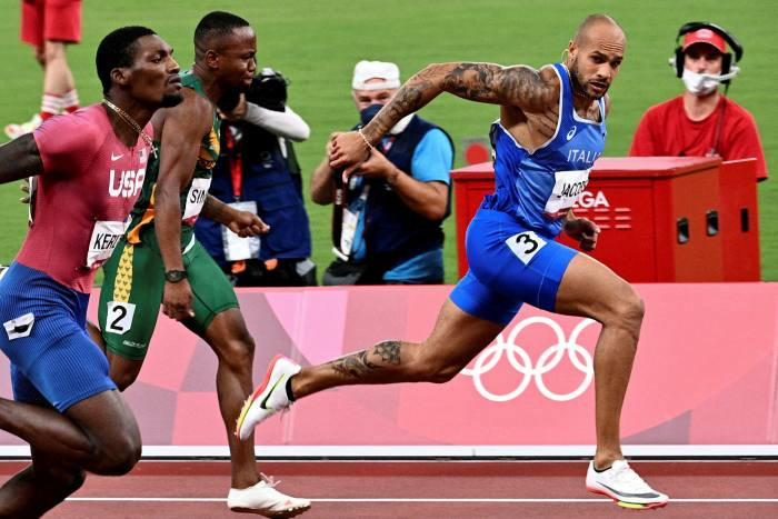 Italian long jumper-turned-short-sprinter Lamont Marcell Jacobs, right, claims victory in the 100 metres