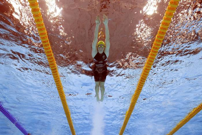 Cate Campbell of Australia competes in the women's 4x100-metre relay at the Tokyo 2020 Olympics