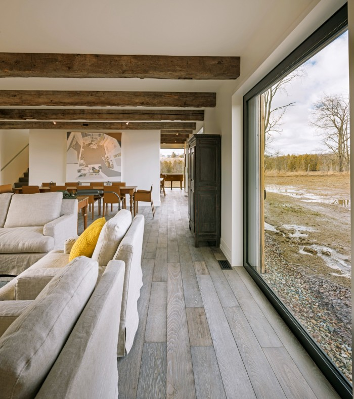 Heavy beams add texture to the interior in the Townships Farmhouse