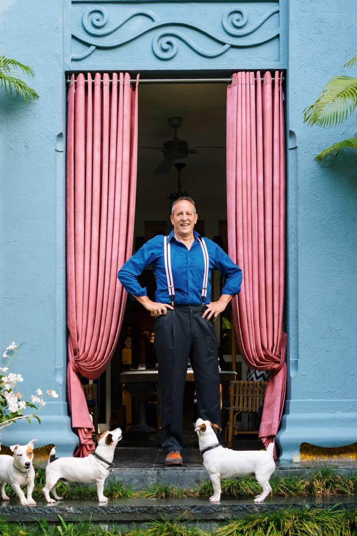 Bangkok-based architect and hotel-designer Bill Bensley with three of the seven Jack Russells he has owned