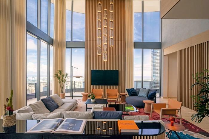 A duplex penthouse in Downtown Miami's Brickell Flatiron Condominium, $9.4m with CMC Real Estate