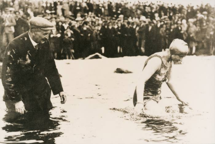 Mercedes Gleitze swims the English Channel with a Rolex Oyster around her neck in 1927