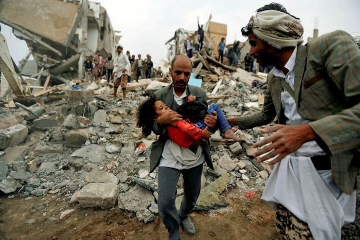 A child is rescued from the site of a Saudi-led air strike in Sanaa, Yemen, in 2017