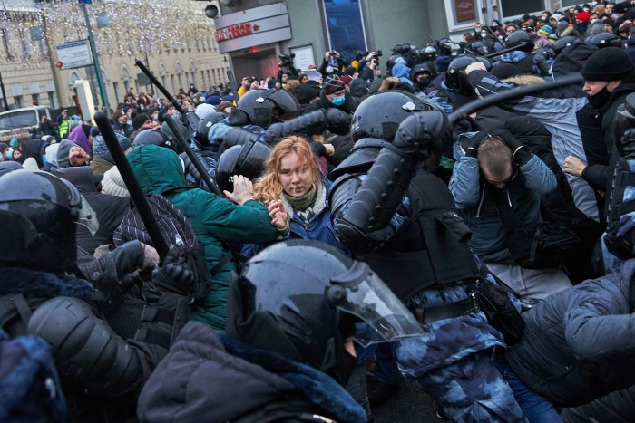 Age of oppression: Riot police and Navalny supporters in Moscow clash during a demonstration in January