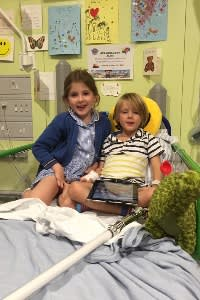 Alfie with his sister Violet on Koala ward at Great Ormond Street before Alfie's surgery