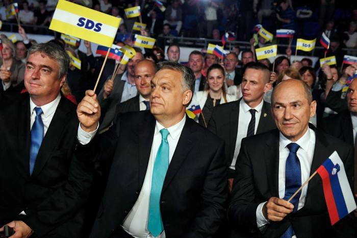 Hungarian Prime Minister Viktor Orban (C), former Slovenian Prime Minister and leader of the Slovenian Democratic Party (SDS) Janez Jansa