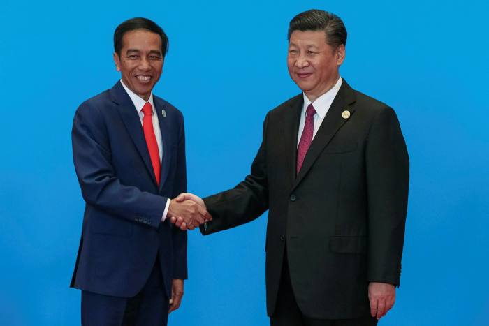 Joko Widodo, left, shakes hands with Xi Jinping at a Belt and Road forum. China has also become Indonesia's largest trading partner