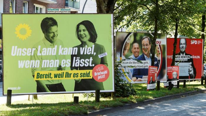 Election posters in Hamburg of the leading candidates to replace Angela Merkel as Germany's chancellor