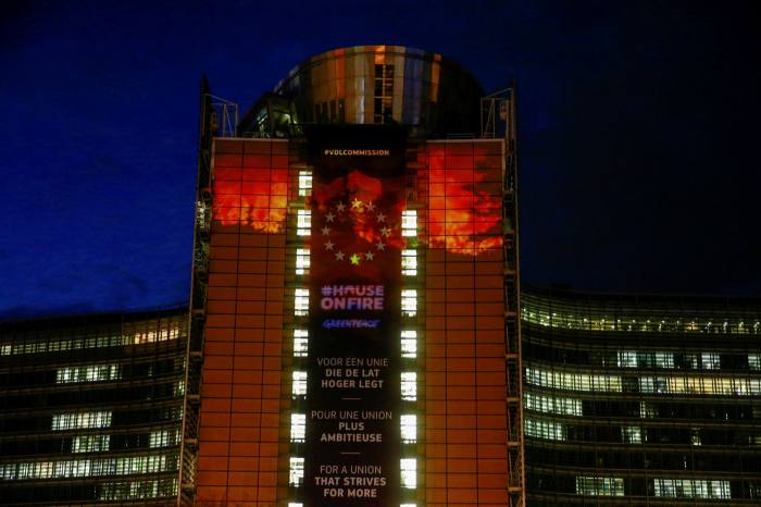 Greenpeace activists project images on the European Commission HQ in Brussels. Insurers and pension funds are taking a bigger interest in carbon as a potential hedge against the effects of climate change