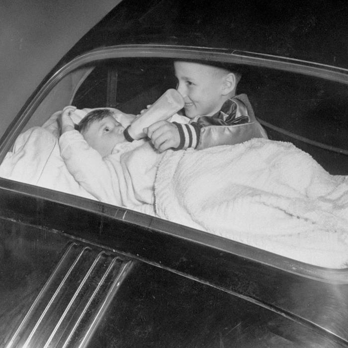 A boy babysits his sister at a drive-in in 1955