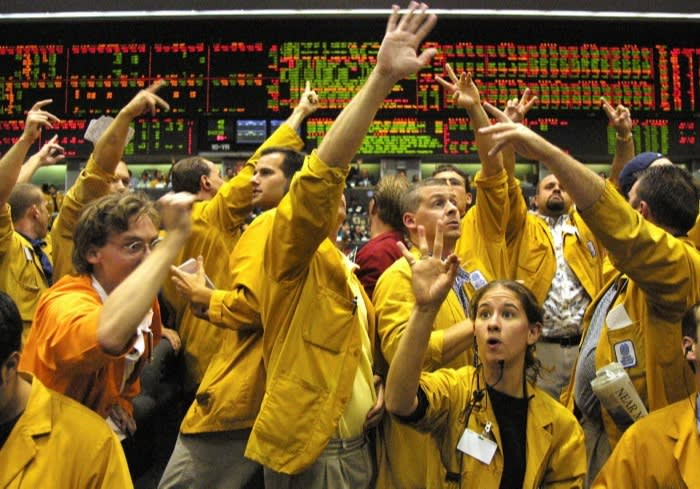Traders and employees work the floor of the Eurodollars exchange pit at the Chicago Mercantile Exchange in 2001