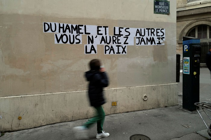 Graffiti in Paris saying 'Duhamel, and the others, you will never be in peace'