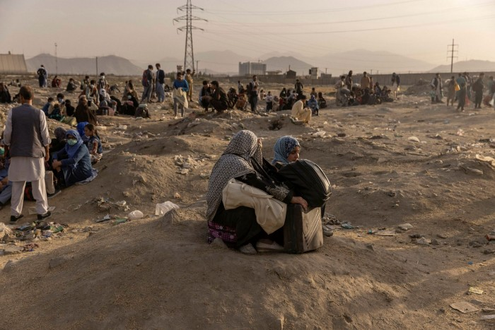 People hoping to flee the country gather outside Kabul airport, August 23