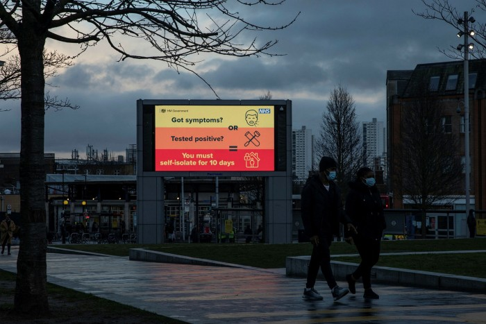 A screen broadcasts public service announcements in east London. Behind the debate over easing lockdown, there is the growing public realisation that the new Covid vaccines will not be the silver bullet they might have seemed in December