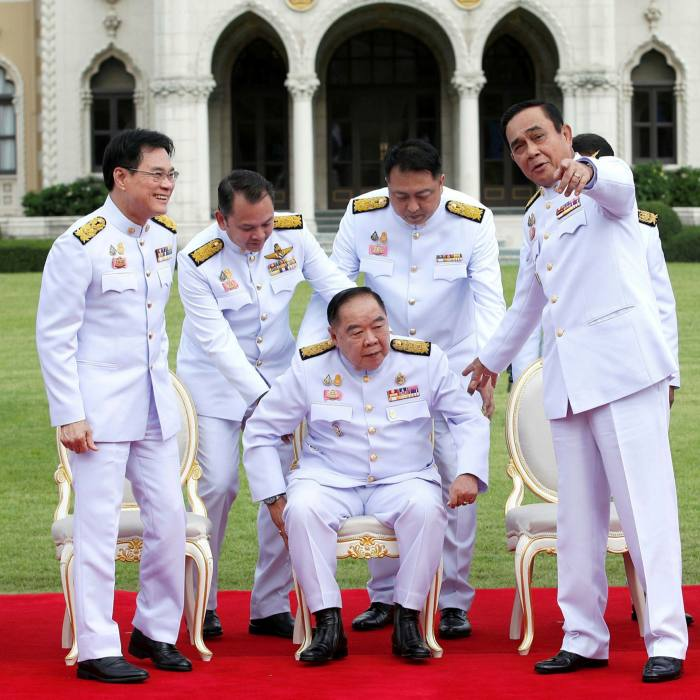 Prime Minister Prayut Chan-o-cha (far right) with deputy prime minister General Prawit Wongsuwan (3-L, sitting) during a group photo after cabinet reshuffle on August 13
