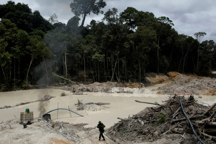 An Ibama agent patrols an illegal mine in Pará state. Salles argues that environmentally destructive activities are driven by a lack of legitimate ways to make a living