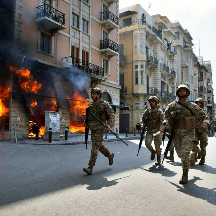 Lebanese soldiers on the streets after the Credit Libanais Bank was set on fire by anti-government protesters in Tripoli in April