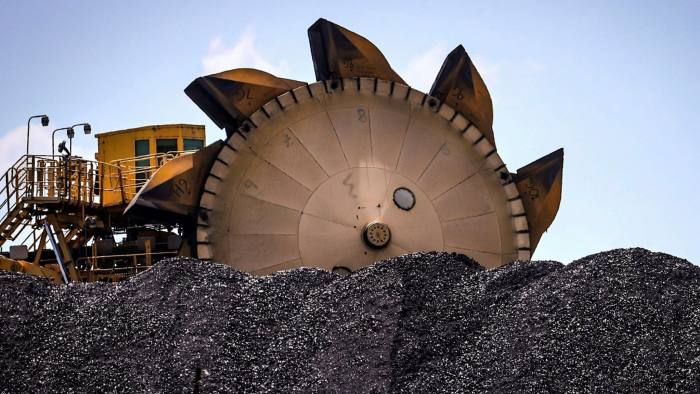 A bucket-wheel reclaimer next to a pile of coal in Australia, in October 2020