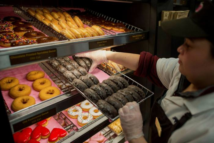 Signs of a recovery have allowed some businesses like Dunkin to restore dividends