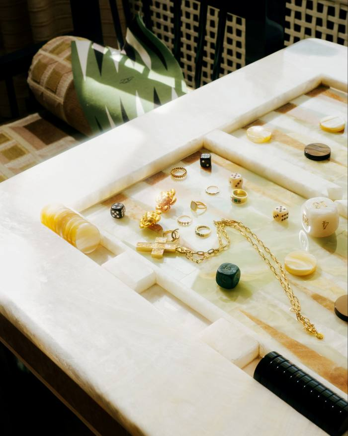 Matching jewelry on a backgammon table