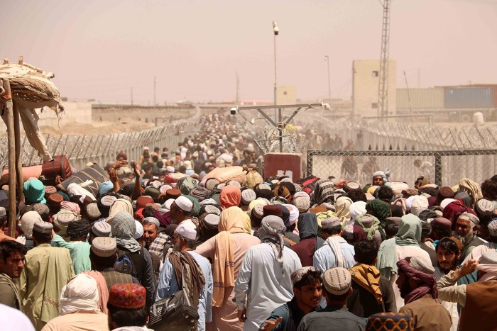 With the Taliban back in power, people wait to enter Pakistan at the Chaman border crossing on August 16