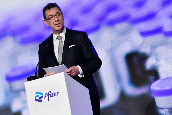 Pfizer CEO Albert Bourla talking  at a press conference