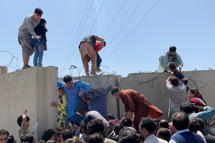 Afghans trying to scale the boundary at Kabul airport,  August 16