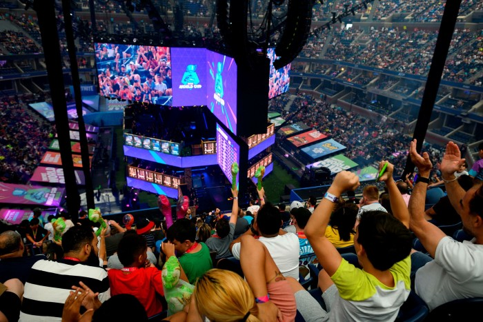 Fans cheer at the 2019 Fortnite World Cup in New York. aXiomatic was among investors, including private equity firm KKR, which injected $1.25bn into Epic Games, the creator of Fortnite