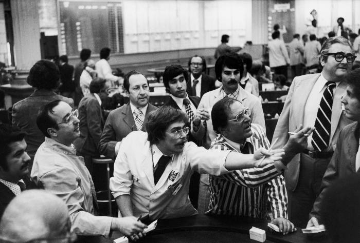 Brokers trade on potato futures on the floor of the New York Mercantile Exchange in May 1976