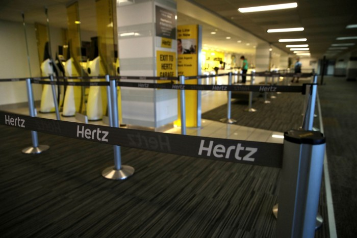An empty Hertz Rent-A-Car rental office at San Francisco International Airport in April  2020